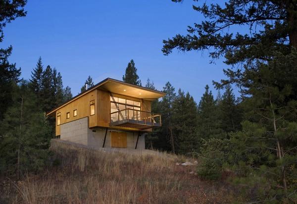 Maison en bois dans une for t de pins - Maison design foret kube architecture ...