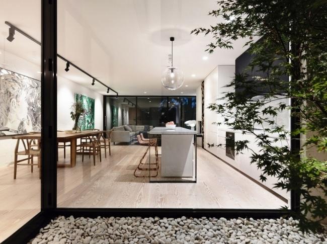 Jardin minimaliste exterieur galets for Galets exterieur jardin