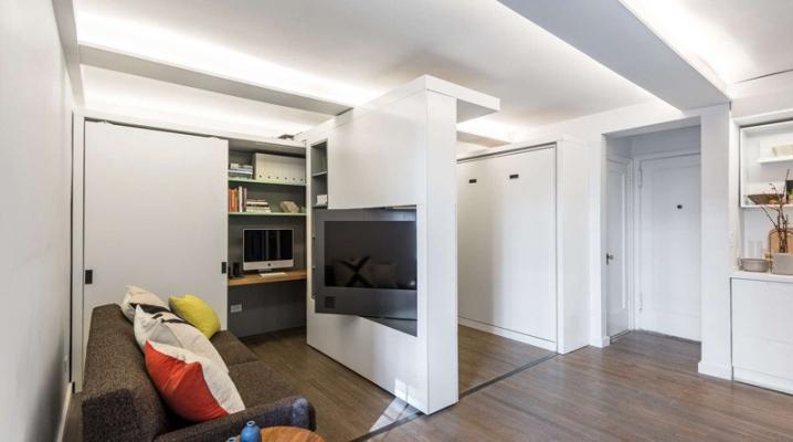 Des murs coulissants motoris s dans un petit appartement - Petit appartement renove transition design ...