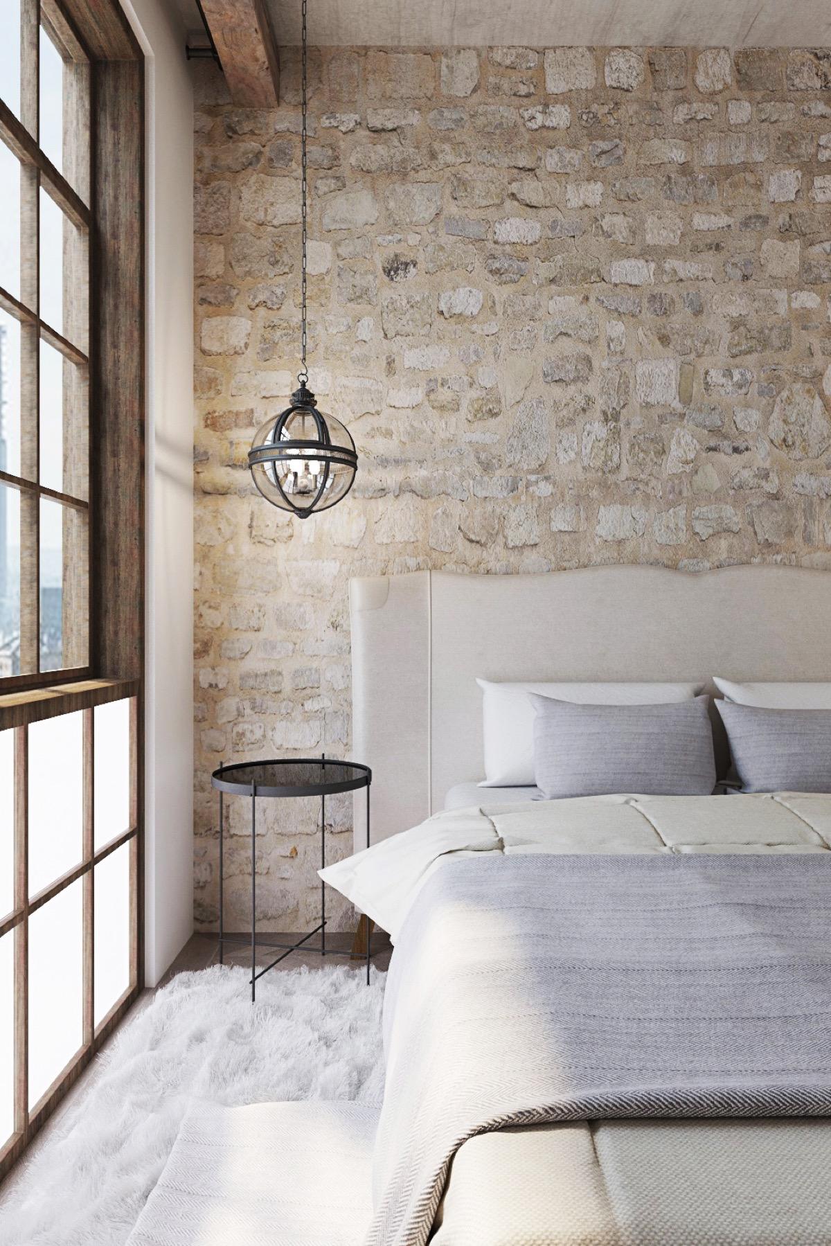 Chambre avec des murs en pierres