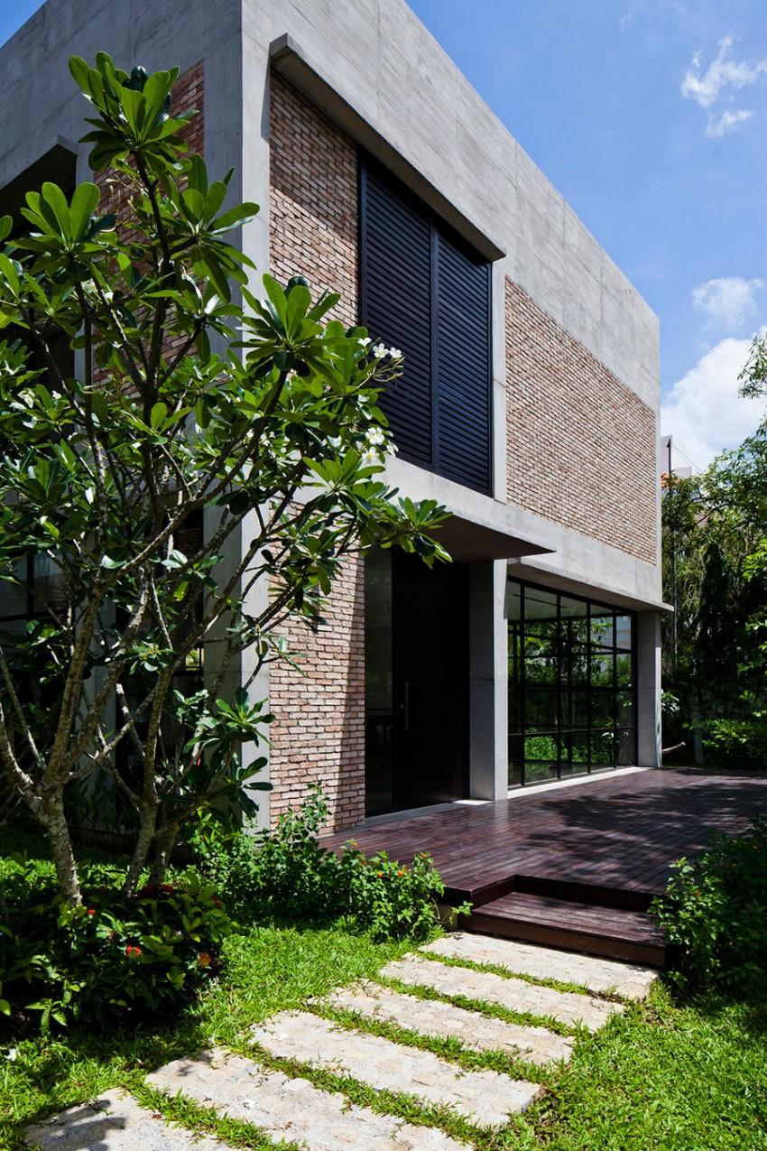 Maison facade briques et b ton for Transformation facade maison